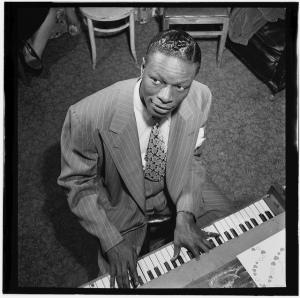 Portrait of Nat King Cole, New York, N.Y., ca. June 1947. William P. Gottlieb, photo [Public domain], via Wikimedia Commons